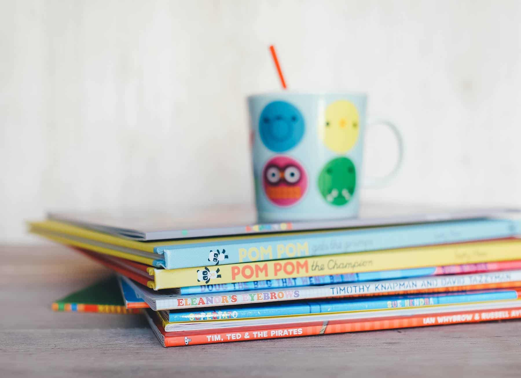 stack of children's books on a table