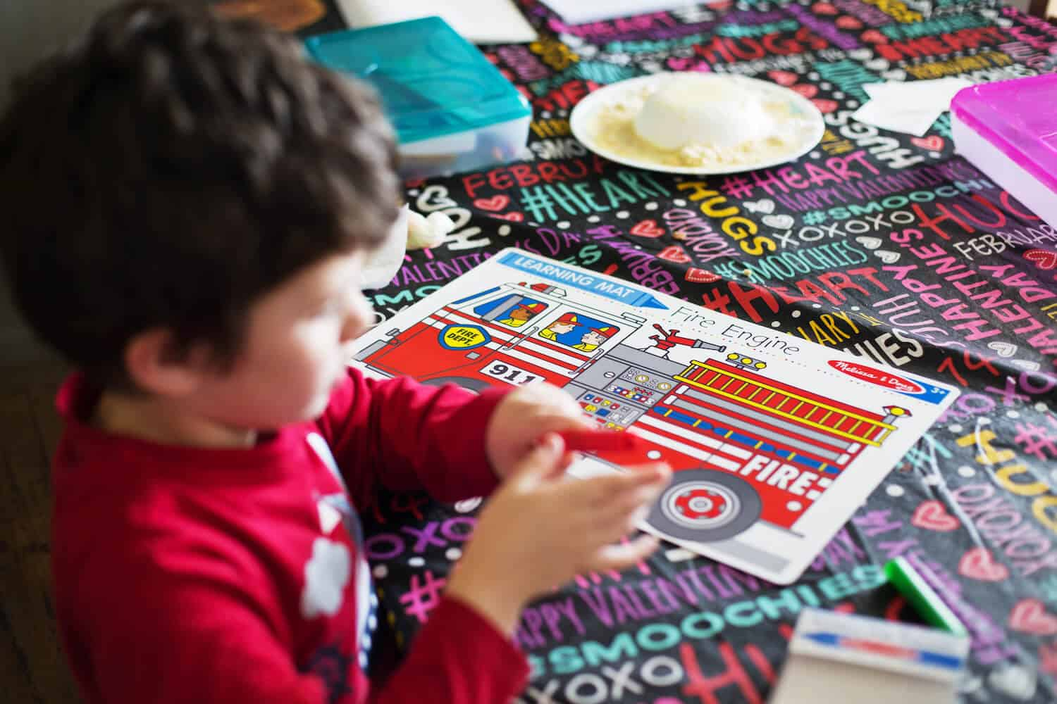 boy playing with fire truck book