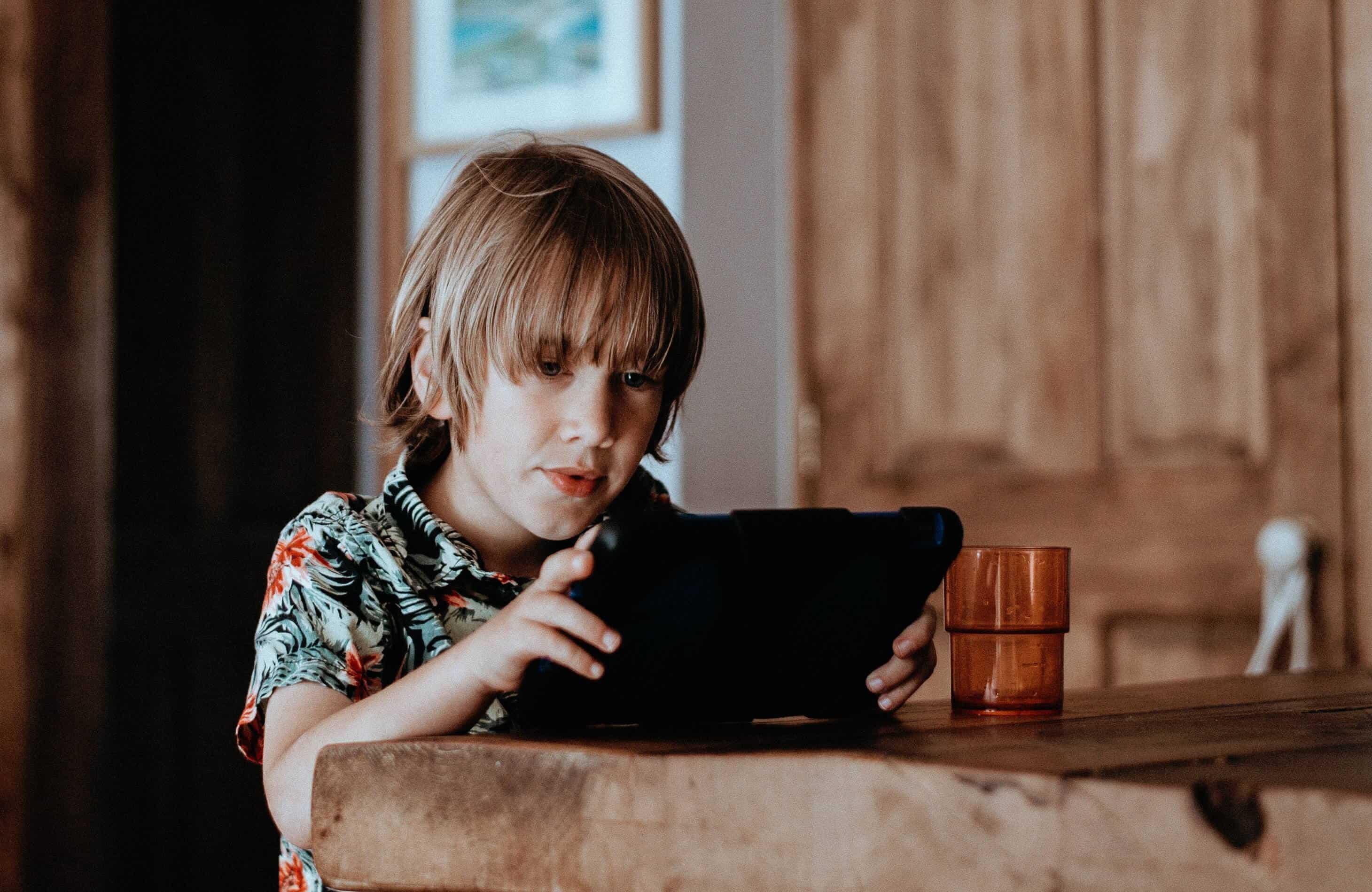 Boy looking at iPad screen
